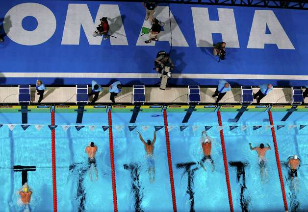 Trevor Hoyt, from left, Scott Weltz, Eric Shanteau, Clark�Burckle, Brendan�Hansen and Elliott Keefer swim in the men's 200-meter breaststroke final at the U.S. Olympic swimming trials, Friday, June 29, 2012, in Omaha, Neb. (AP Photo/Nati Harnik) Photo: Associated Press