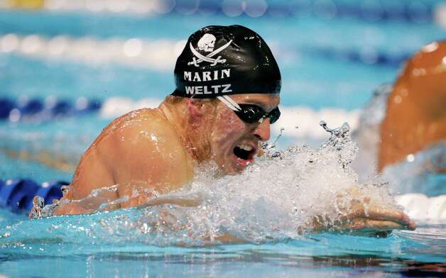 Scott Weltz swims to victory in the men's 200-meter breaststroke final at the U.S. Olympic swimming trials on Friday, June 29, 2012, in Omaha, Neb. (AP Photo/Mark Humphrey) Photo: Associated Press