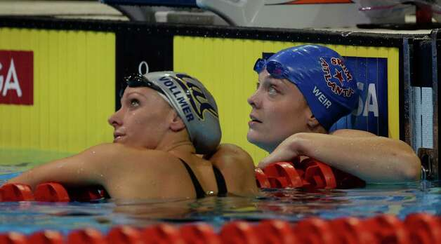Dana Vollmer, left, and Amanda Weir look at the clock after swimming in a women's 100-meter freestyle semifinal at the U.S. Olympic swimming trials on Friday, June 29, 2012, in Omaha, Neb. (AP Photo/Mark Humphrey) Photo: Associated Press