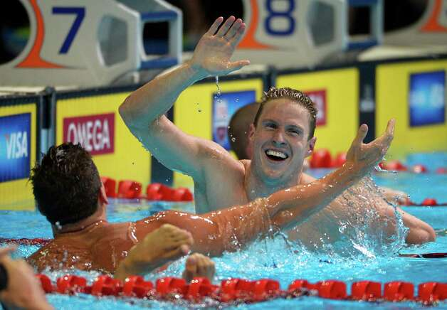 Scott Weltz celebrates with Eric Shanteau, left, after winning the men's 200-meter breaststroke final at the U.S. Olympic swimming trials, Friday, June 29, 2012, in Omaha, Neb. (AP Photo/Mark J. Terrill) Photo: Associated Press
