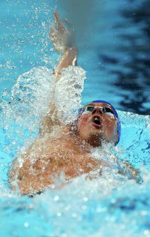 Ryan Lochte swims in a men's 200-meter backstroke semifinal at the U.S. Olympic swimming trials on Friday, June 29, 2012, in Omaha, Neb. (AP Photo/Mark Humphrey) Photo: Associated Press