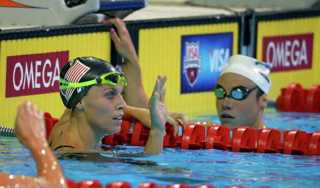 Amanda Beard waves after swimming in the women's 200-meter breaststroke preliminaries at the U.S. Olympic swimming trials, Friday, June 29, 2012, in Omaha, Neb. At right is Katy Freeman. (AP Photo/Mark J. Terrill) Photo: Associated Press