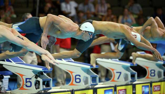 Michael Phelps dives as the start of a heat in the men's 200-meter individual medley preliminaries at the U.S. Olympic swimming trials, Friday, June 29, 2012, in Omaha, Neb. (AP Photo/Mark J. Terrill) Photo: Associated Press
