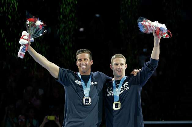 Clark Burckle, left, and Scott Weltz wave during the medal ceremony for the men's 200-meter breaststroke at the U.S. Olympic swimming trials on Friday, June 29, 2012, in Omaha, Neb. (AP Photo/Mark Humphrey) Photo: Associated Press