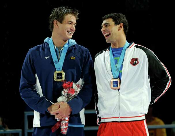 Nathan Adrian, left, and Ricky Berens smile during the medal ceremony for the men's 100-meter freestyle at the U.S. Olympic swimming trials on Friday, June 29, 2012, in Omaha, Neb. (AP Photo/Mark Humphrey) Photo: Associated Press