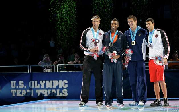 Matt Grevers, from left, Cullen Jones, Nathan Adrian and Ricky Berens pose during the medal ceremony for the men's 100-meter freestyle at the U.S. Olympic swimming trials, Friday, June 29, 2012, in Omaha, Neb. (AP Photo/Mark Humphrey) Photo: Associated Press