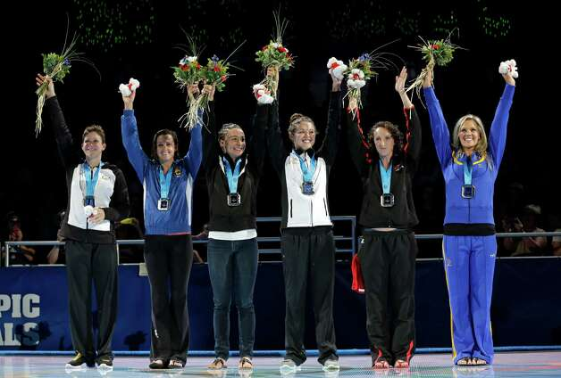 Caitlin Leverenz, from left, Rebecca Soni, Ariana Kukors, Rachel Bootsma, Claire Donahue and Chloe Sutton wave as they are qualified for the U.S. Olympic team during the medal ceremony at the U.S. Olympic swimming trials, Friday, June 29, 2012, in Omaha, Neb. (AP Photo/Mark Humphrey) Photo: Associated Press