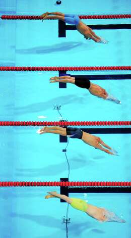 Robert Margalis, from top, Ryan Lochte, Michael Phelps and Jack Brown dive at the start of a men's 200-meter individual medley semifinal at the U.S. Olympic swimming trials, Friday, June 29, 2012, in Omaha, Neb. (AP Photo/Mark J. Terrill) Photo: Associated Press