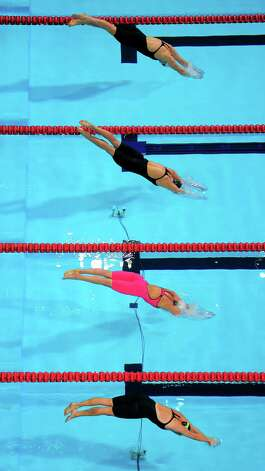 Caitlin Leverenz, from top, Andrea Kropp, Rebecca Soni and Amanda Beard dive at the start of a women's 200-meter breaststroke semifinal at the U.S. Olympic swimming trials, Friday, June 29, 2012, in Omaha, Neb. (AP Photo/Mark J. Terrill) Photo: Associated Press