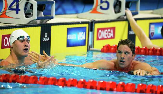 Conor Dwyer, right, shakes his hand with Peter Vanderkaay after swimming in a men's 200-meter individual medley semifinal at the U.S. Olympic swimming trials, Friday, June 29, 2012, in Omaha, Neb. (AP Photo/Mark J. Terrill) Photo: Associated Press