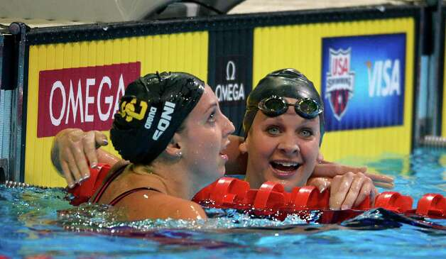 Rebecca Soni, left, and Andrea Kropp talk after swimming in  a women's 200-meter breaststroke semifinal at the U.S. Olympic swimming trials, Friday, June 29, 2012, in Omaha, Neb. (AP Photo/Mark J. Terrill) Photo: Associated Press