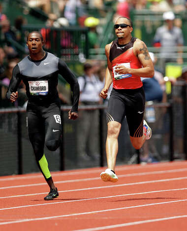 Shawn Crawford, left, and Wallace Spearmon Jr., compete in the qualifying round of the men's 200 meters at the U.S. Olympic Track and Field Trials Friday, June 29, 2012, in Eugene, Ore. (AP Photo/Marcio Jose Sanchez) Photo: Associated Press