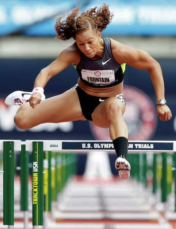Heptathlete Hyleas Fountain competes in the 100 meter hurdles at the U.S. Olympic Track and Field Trials Friday, June 29, 2012, in Eugene, Ore. (AP Photo/Eric Gay) Photo: Associated Press