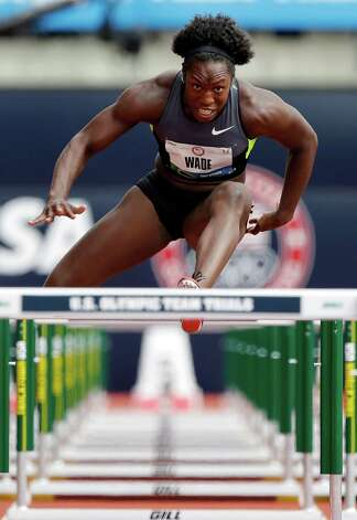Heptathlete Bettie Wade competes in the 100 meter hurdles at the U.S. Olympic Track and Field Trials Friday, June 29, 2012, in Eugene, Ore. (AP Photo/Eric Gay) Photo: Associated Press