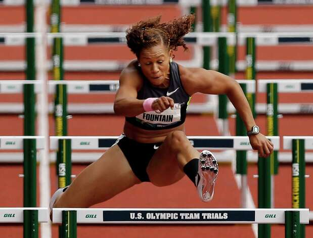 Heptathlete Hyleas Fountain competes in the 100 meter hurdles at the U.S. Olympic Track and Field Trials Friday, June 29, 2012, in Eugene, Ore. (AP Photo/Marcio Jose Sanchez) Photo: Associated Press
