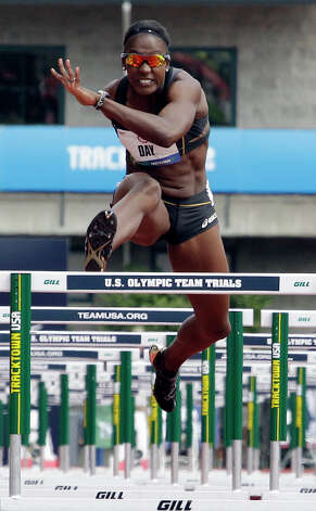 Heptathlete Sharon Day competes in the 100 meter hurdles at the U.S. Olympic Track and Field Trials Friday, June 29, 2012, in Eugene, Ore. (AP Photo/Eric Gay) Photo: Associated Press