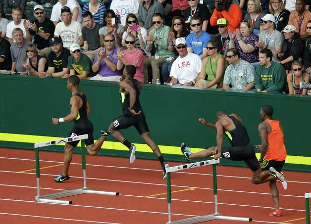 Competitors race in the second heat of the men's 400 meter hurdles semi-finals at the U.S. Olympic Track and Field Trials Friday, June 29, 2012, in Eugene, Ore. (AP Photo/Marcio Jose Sanchez) Photo: Associated Press