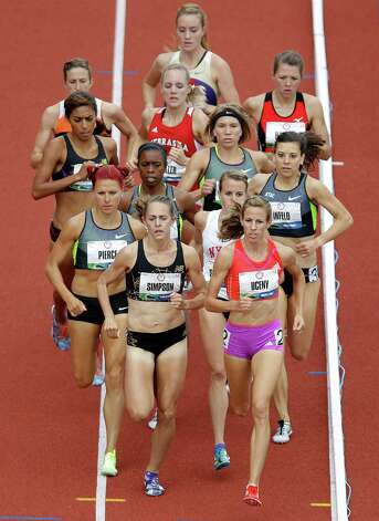 Jenny Simpson, front left, and Morgan Uceny, front right, lead their heat in the women's 1500 meter semi-finals  at the U.S. Olympic Track and Field Trials Friday, June 29, 2012, in Eugene, Ore. (AP Photo/Marcio Jose Sanchez) Photo: Associated Press