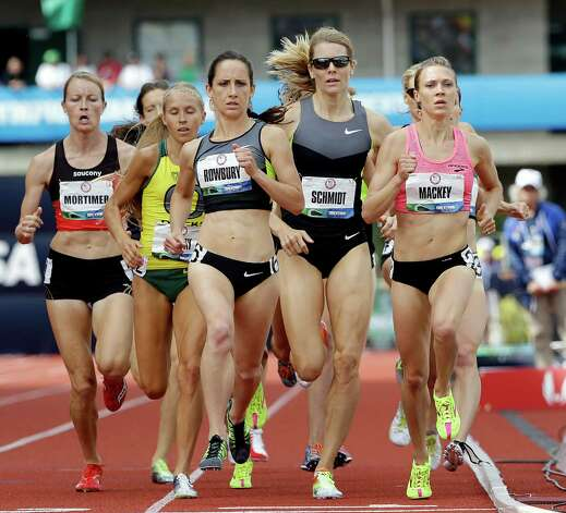 Sharon Rowbury, center left, leads her heat in the women's 1500 meter semi-finals  at the U.S. Olympic Track and Field Trials Friday, June 29, 2012, in Eugene, Ore. (AP Photo/Eric Gay) Photo: Associated Press