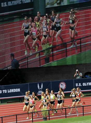 Competitors race in heat two of the women's 1500 meter semi-finals  at the U.S. Olympic Track and Field Trials Friday, June 29, 2012, in Eugene, Ore. (AP Photo/Marcio Jose Sanchez) Photo: Associated Press