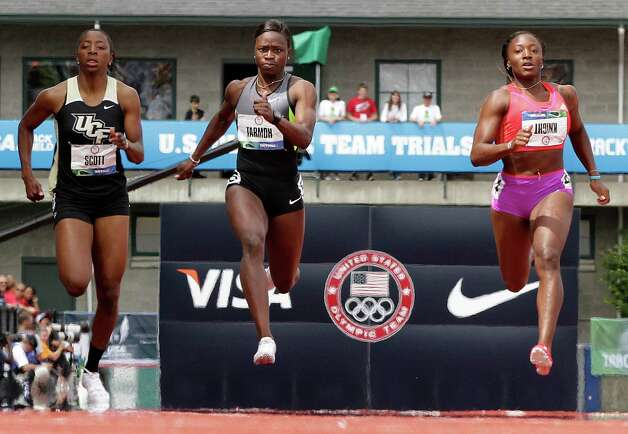 Aurieyall Scott, left, Jeneba Tarmoh, center, and Bianca Knight compete in the  women's 200 meter semi-finals at the U.S. Olympic Track and Field Trials Friday, June 29, 2012, in Eugene, Ore. (AP Photo/Eric Gay) Photo: Associated Press
