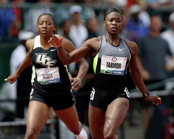 Jeneba Tarmoh, right, finishes her heat in the women's 200 meter semi-finals at at the U.S. Olympic Track and Field Trials Friday, June 29, 2012, in Eugene, Ore. Aurieyall Scott is at left. (AP Photo/Marcio Jose Sanchez) Photo: Associated Press