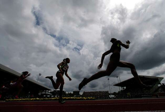 Runners are silhouetted against a cloudy sky during the women's 200 meter third heat in the semi-final round at the U.S. Olympic Track and Field Trials Friday, June 29, 2012, in Eugene, Ore. (AP Photo/Charlie Riedel) Photo: Associated Press