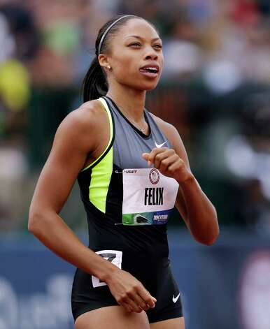 Allyson Felix finishes her heat in the women's 200 meter semi-finals at at the U.S. Olympic Track and Field Trials Friday, June 29, 2012, in Eugene, Ore. (AP Photo/Marcio Jose Sanchez) Photo: Associated Press