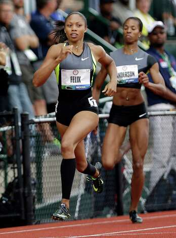 Allyson Felix competes in her heat in the women's 200 meter semi-finals at at the U.S. Olympic Track and Field Trials Friday, June 29, 2012, in Eugene, Ore. Alexandria Anderson is at right. (AP Photo/Marcio Jose Sanchez) Photo: Associated Press