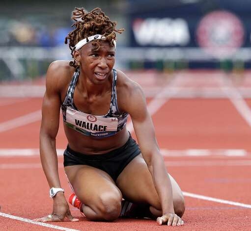 Latosha Wallace falls to the track after just missing her chance to advance to the finals in the women's 400 meter hurdles semi-finals at the U.S. Olympic Track and Field Trials Friday, June 29, 2012, in Eugene, Ore. (AP Photo/Eric Gay) Photo: Associated Press