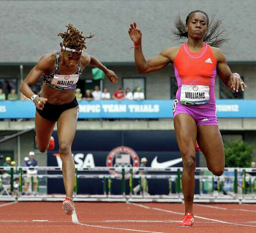 Latosha Wallace, left, and Tiffany Williams lunge for the finish  in the women's 400 meter hurdles semi-finals at the U.S. Olympic Track and Field Trials Friday, June 29, 2012, in Eugene, Ore. Wallace did not make the finals and Williams finished second to advance. (AP Photo/Eric Gay) Photo: Associated Press
