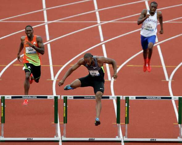 Angelo Taylor, center, leads his heat in the men's 400 meter hurdles semi-finals at the U.S. Olympic Track and Field Trials Friday, June 29, 2012, in Eugene, Ore. (AP Photo/Marcio Jose Sanchez) Photo: Associated Press