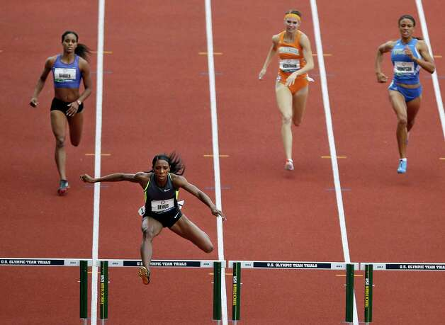 Lashinda Demus, front center, leads her heat in the women's 400 meter hurdles semi-finals at the U.S. Olympic Track and Field Trials Friday, June 29, 2012, in Eugene, Ore. (AP Photo/Marcio Jose Sanchez) Photo: Associated Press
