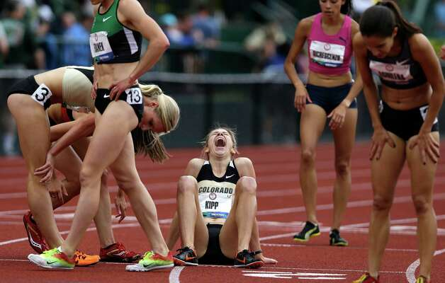 Shalaya Kipp, center, reacts after realizing she will advance to the Olympics after finishing the women's 3000 meter steeplechase at the U.S. Olympic Track and Field Trials Friday, June 29, 2012, in Eugene, Ore.(AP Photo/Marcio Jose Sanchez) Photo: Associated Press