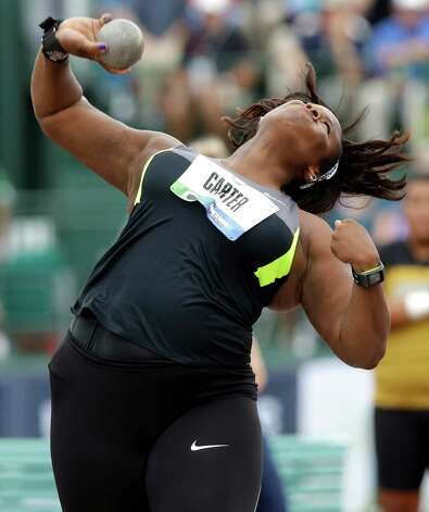 Michelle Carter competes in the final round of the women's shot put at the U.S. Olympic Track and Field Trials Friday, June 29, 2012, in Eugene, Ore. Carter placed second.  ((AP Photo/Charlie Riedel) Photo: Associated Press
