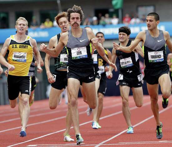 William Leer, center, finishes first in the second heat of the men's 1500 meter semi-finals at the U.S. Olympic Track and Field Trials Friday, June 29, 2012, in Eugene, Ore.   (AP Photo/Eric Gay) Photo: Associated Press