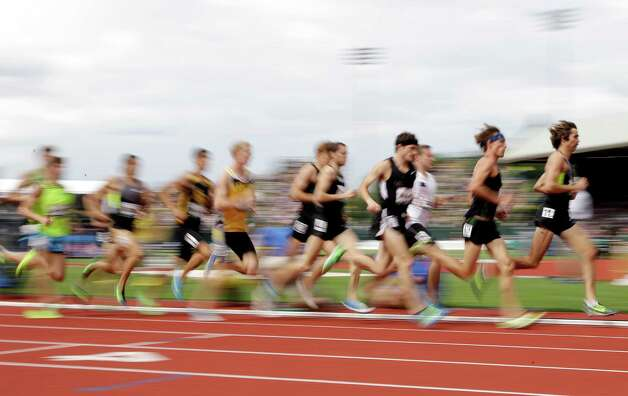 William Leer, far right, leads the second heat of the men's 1500 meter semi-finals at the U.S. Olympic Track and Field Trials Friday, June 29, 2012, in Eugene, Ore.  (AP Photo/Eric Gay) Photo: Associated Press