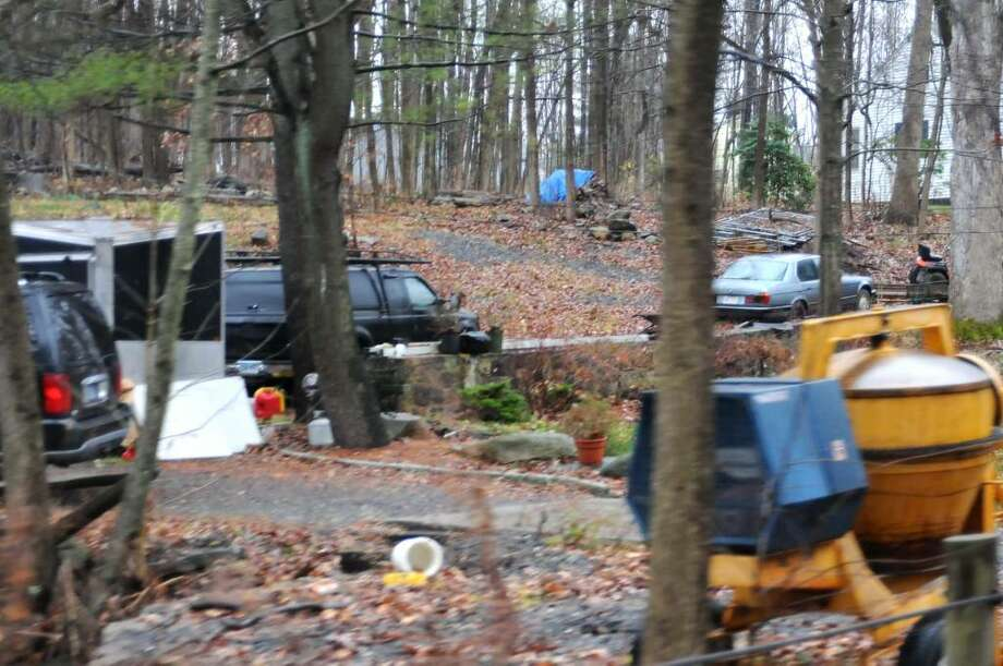 This house at 140 Padanaram, Danbury, CT is considered an eyesore, with trailers and construction equipment scattered all over the property. Photo taken on Friday, Nov. 27, 2009 Photo: Jay Weir / The News-Times