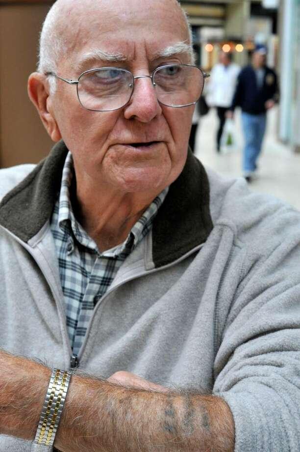 Al Wildman, of New Milford, displays his 1947 tattoo, on Thursday, Nov.12,2009. Photo: Michael Duffy / The News-Times