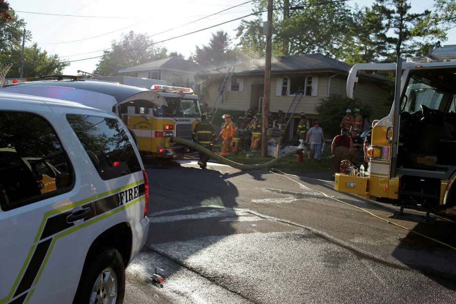 The East Greenbush and Clifton Heights Fire Departments mutually aid in response to a house fire on Chestnut Court in East Greenbush, Friday, June 22, 2012. (Dan Little/Special to the Times Union) Photo: Dan Little / 00018316A