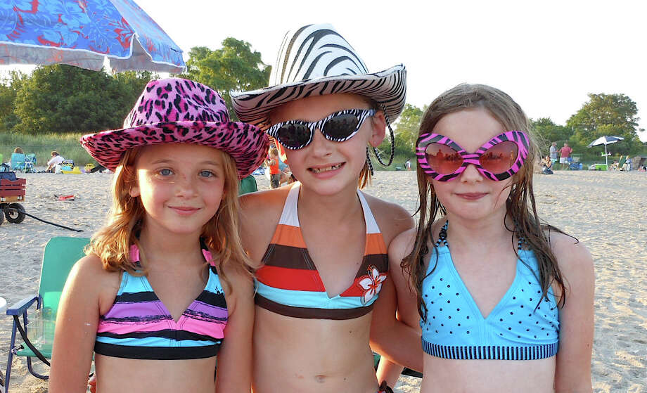 July birthday girls Mya Krasowski, Kiley Kellerman and Alison Jaeger of Fairfield at the Sand Jam on Jennings Beach Friday. Photo: Mike Lauterborn / Fairfield Citizen contributed