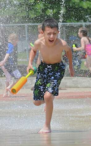 Carlos Guerrero, 8, of Saratoga Springs cools off in the Geyser Park Spray Pad on Cady Hill Boulevard, June 29, 2012 in Saratoga Springs, N.Y. (Lori Van Buren / Times Union) Photo: Lori Van Buren