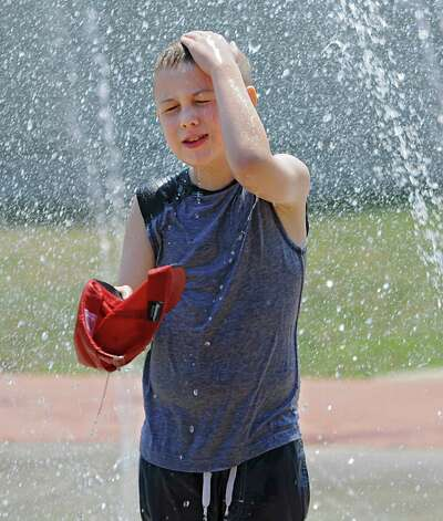 Derek Graff, 7, of Saratoga Springs cools off in the Geyser Park Spray Pad on Cady Hill Boulevard, June 29, 2012 in Saratoga Springs, N.Y. (Lori Van Buren / Times Union) Photo: Lori Van Buren
