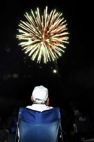 Jack Buttridge of Schenectady watches the fireworks on Friday, June 29, 2012, at Freedom Park in Scotia, N.Y. (Cindy Schultz / Times Union) Photo: Cindy Schultz / 00018293A