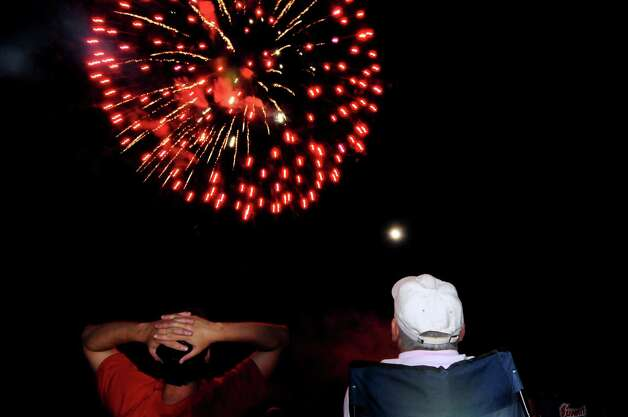Jack Buttridge of Schenectady, right, and his son Joseph watch the fireworks on Friday, June 29, 2012, at Freedom Park in Scotia, N.Y. (Cindy Schultz / Times Union) Photo: Cindy Schultz / 00018293A