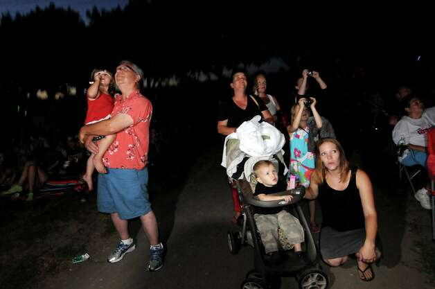 Families watch the fireworks show on Friday, June 29, 2012, at Freedom Park in Scotia, N.Y. (Cindy Schultz / Times Union) Photo: Cindy Schultz / 00018293A