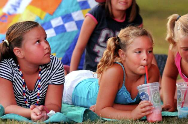 Friends Sophia Dlugolecki, 7, and Gia Verdi, 7, both of Scotia, wait for the fireworks show to start on Friday, June 29, 2012, at Freedom Park in Scotia, N.Y. (Cindy Schultz / Times Union) Photo: Cindy Schultz / 00018293A