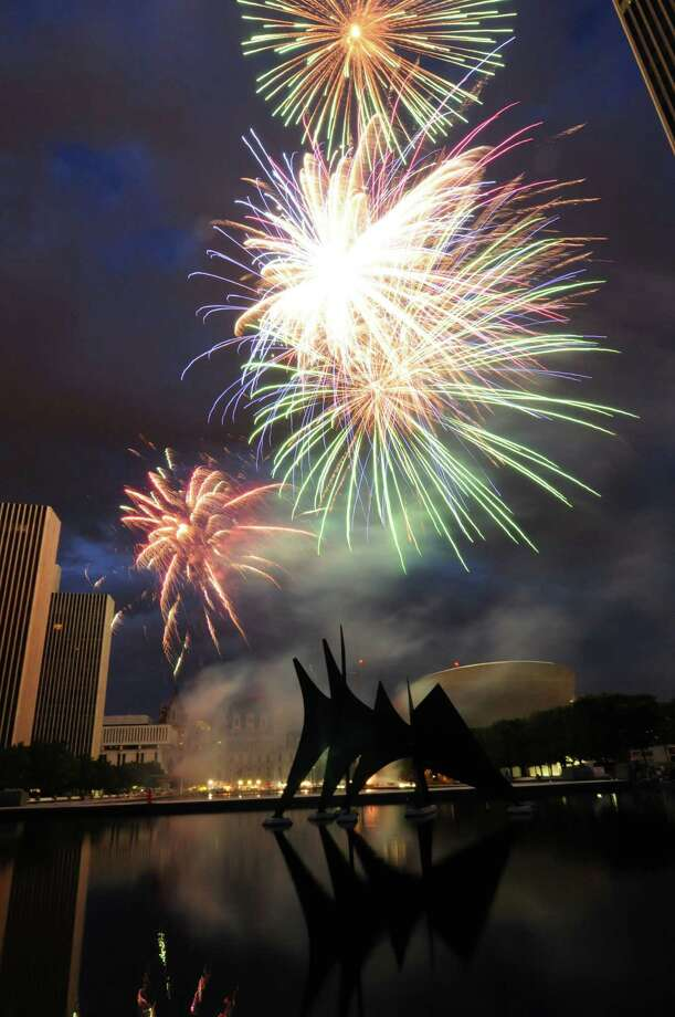 Fireworks light up the sky above Empire State Plaza in Albany, N.Y., Monday July 4, 2011, during Price Chopper's Homegrown 4th and Fireworks Festival show. (Will Waldron /Times Union) Photo: Will Waldron