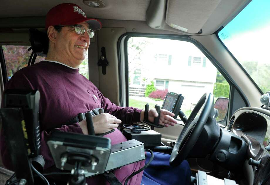Tim Carter drives his modified van Tuesday, May, 1, 2012 near his home in Trumbull, Conn.  Carter, a quadriplegic, relies on his high-tech minivan to get around. The equipment that enables him to drive is more than 10-years-old and failing and the manufacturer will not repair it. But now, thanks to the generosity from strangers will allow him to fix his van. Photo: Autumn Driscoll / Connecticut Post