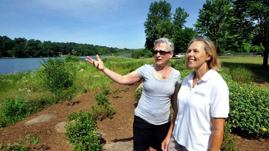 Jane Didona, the landscape architect, left, and Camilla Worden, the garden designer responsible for the gardens, talk during the opening cermonies for the Lake Kenosia Buffer Gardens in Danbury Saturday, June 30, 2012. Photo: Michael Duffy / The News-Times